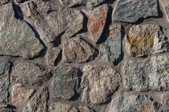 Textures stone background old wall made of pieces of granite Royalty Free Stock Images