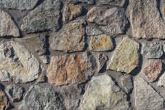 Textures stone background old wall of pieces of granite Royalty Free Stock Images