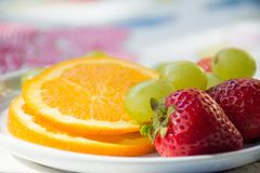 Bright and shine. The textures and  the taste of juice Oranges, filling the desire for fresh fruits in the morning. Morning Breakfast. Fresh Strawberries Royalty Free Stock Image