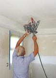 Texturing ceilings. Painter spraying texture on ceilings, house is being updated  to put on the market to be sold Stock Images