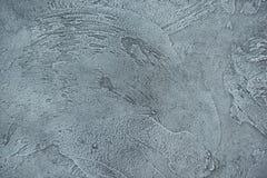 Texturized grå färgspackel Tappning eller grungy bakgrund av Venetian stuckaturtextur som modellväggen Arkivfoton