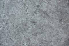 Texturized grå färgspackel Tappning eller grungy bakgrund av Venetian stuckaturtextur som modellväggen Arkivbild