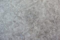 Texturized grå färgspackel Tappning eller grungy bakgrund av Venetian stuckaturtextur som modellväggen Royaltyfri Bild