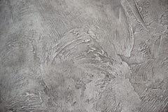 Texturized grijze stopverf Uitstekende of grungy achtergrond van Venetiaanse gipspleistertextuur als patroonmuur Stock Afbeelding