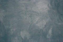 Texturmörker - gråa väggar Bakgrund präglad Murbrukmålarfärg Arkivbild