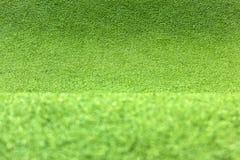 Texturmatta för grönt gräs för bakgrund royaltyfri bild