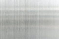 texturmetallbakgrund av den borstade stålplattan Arkivbild