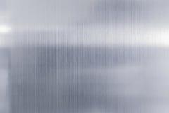texturmetallbakgrund av den borstade stålplattan Royaltyfri Fotografi