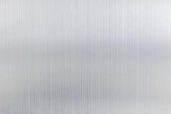 texturmetallbakgrund av den borstade stålplattan Arkivfoto