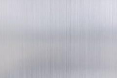 texturmetallbakgrund av den borstade stålplattan Royaltyfria Foton