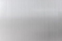 texturmetallbakgrund av den borstade stålplattan Royaltyfria Bilder