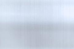 texturmetallbakgrund av den borstade stålplattan Royaltyfri Foto