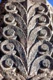 Texturstenskulptur beväpnade royaltyfria bilder