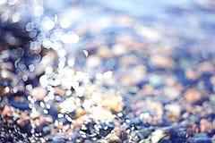 Texturvatten Pebble Beach Arkivbilder