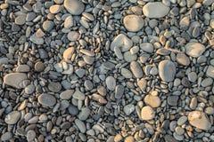Textuur, achtergrond, kiezelstenen, grijze stenen op het strand Royalty-vrije Stock Afbeelding