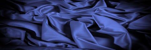 Textuur, achtergrond, patroon De donkerblauwe sering van de zijdestof dit Royalty-vrije Stock Afbeelding
