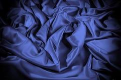 Textuur, achtergrond, patroon De donkerblauwe sering van de zijdestof dit Stock Fotografie