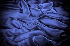 Textuur, achtergrond, patroon De donkerblauwe sering van de zijdestof dit Stock Afbeeldingen