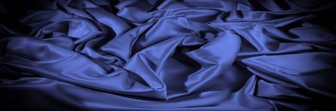 Textuur, achtergrond, patroon De donkerblauwe sering van de zijdestof dit Stock Afbeelding