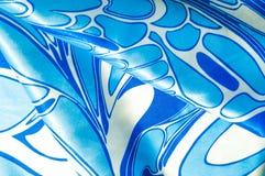 Textuur, achtergrond, patroon De de zijdezakdoek van een vrouw sjaal Stock Foto's