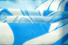 Textuur, achtergrond, patroon De de zijdezakdoek van een vrouw sjaal Royalty-vrije Stock Afbeeldingen