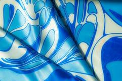 Textuur, achtergrond, patroon De de zijdezakdoek van een vrouw sjaal Stock Afbeelding