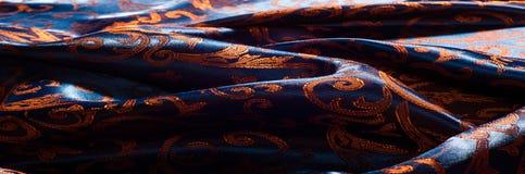 Textuur, achtergrond, patroon het Koninklijke monogram van de zijdedoek Mozes V royalty-vrije stock afbeeldingen