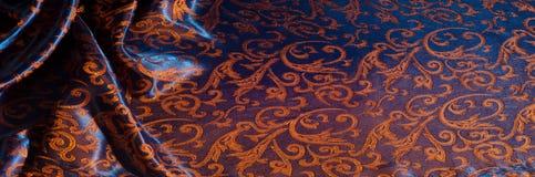 Textuur, achtergrond, patroon het Koninklijke monogram van de zijdedoek Mozes V royalty-vrije stock foto's