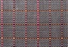 Textuur een bamboe met stof het weven Stock Afbeeldingen