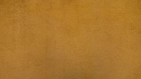 Textuur gele gepleisterde muur stock foto