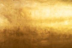 Textuur of gouden schaduw als achtergrond en gradiënt royalty-vrije stock afbeeldingen