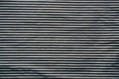 Textuur met directe lijnen op verpletterde kleren stock foto's