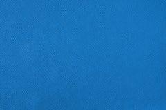 Textuur met een patroon van een meerderheid van lijnen Gekleurde blauwe achtergrond stock foto's