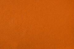 Textuur met een patroon van een meerderheid van lijnen Gekleurde oranje achtergrond stock fotografie