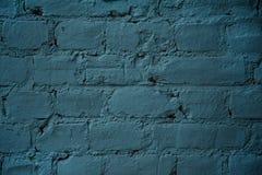 Textuur van bakstenen muur met blauwe verf wordt behandeld die Royalty-vrije Stock Afbeeldingen