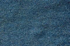 Textuur van blauw denim zonder naden en knopenclose-upschot royalty-vrije stock foto's