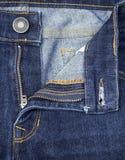 Textuur van blauwe denimjeans met knoop en pit Stock Afbeelding