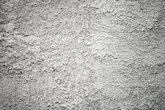 Textuur van de close-up de grijze concrete muur met pleister Stock Fotografie