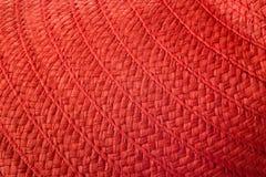 Textuur van de het strohoed van de vrouwen` s zomer de rode Royalty-vrije Stock Afbeeldingen