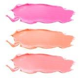 Textuur van de lippenstift van verschillende die kleuren op witte achtergrond worden geïsoleerd Reeks multicolored slagen Kosmeti Royalty-vrije Stock Fotografie