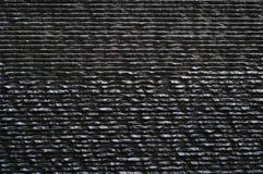 Textuur van de muur de donkere steen, achtergrond Stock Fotografie