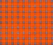 Textuur van de oranje textielstof van de geruit Schots wollen stofplaid Stock Foto's