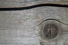 Textuur van de oude grijze raad met knopen en de spleet Royalty-vrije Stock Foto