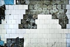 Textuur van de oude tegelmuur met barsten Stock Afbeeldingen