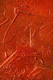 Textuur van de rode gipspleistermuur met scharren Stock Afbeeldingen