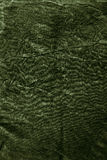 Textuur van donkere kaki verfrommelde stof Stock Foto's
