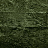 Textuur van donkere kaki verfrommelde stof Stock Foto