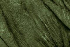 Textuur van donkere kaki verfrommelde stof Royalty-vrije Stock Fotografie