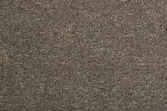 Textuur van een eenvoudig tapijt Grijze achtergrond stock afbeeldingen