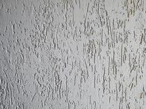 Textuur van een fragment van een muur van een moderne structuur van witte kleur Ruwheid in de stijl van schorskever Een achtergro stock fotografie
